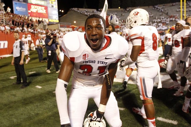 Aug 29, 2013; Fresno, CA, USA; Fresno State Bulldogs linebacker Ejiro Ederaine (31) celebrates after the Bulldogs defeated the Rutger Scarlet Knights at Bulldog Stadium. The Bulldogs defeated the Scarlet Knights 52-51 in overtime. Mandatory Credit: Cary Edmondson-USA TODAY Sports