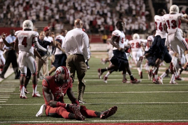 Aug 29, 2013; Fresno, CA, USA; Rutgers Scarlet Knights wide receiver Brandon Coleman (17) sits on the ground after the Scarlet Knights failed to convert on a two point conversion against the Fresno State Bulldogs in overtime at Bulldog Stadium. The Bulldogs defeated the Scarlet Knights 52-51 in overtime. Mandatory Credit: Cary Edmondson-USA TODAY Sports