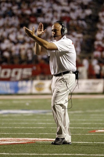 Aug 29, 2013; Fresno, CA, USA; Rutgers Scarlet Knights head coach Kyle Flood reacts after his team converted a two point conversion against the Fresno State Bulldogs in the third quarter at Bulldog Stadium. The Bulldogs defeated the Scarlet Knights 52-51 in overtime. Mandatory Credit: Cary Edmondson-USA TODAY Sports