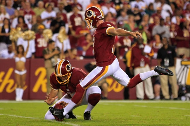 Aug 19, 2013; Landover, MD, USA; Washington Redskins kicker Kai Forbath (2) kicks the ball against the Pittsburgh Steelers at FedEx Field. Mandatory Credit: Geoff Burke-USA TODAY Sports