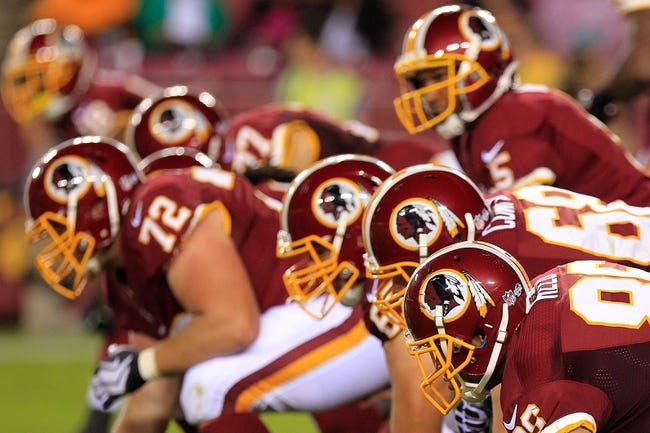 Aug 19, 2013; Landover, MD, USA; Washington Redskins offensive players line up against the Pittsburgh Steelers at FedEx Field. Mandatory Credit: Geoff Burke-USA TODAY Sports