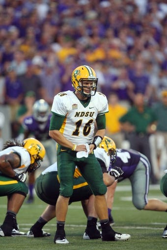 Aug 30, 2013; Manhattan, KS, USA; North Dakota State Bison quarterback Brock Jensen (16) calls a play during first-half action against the Kansas State Wildcats at Bill Snyder Family Stadium. Mandatory Credit: Scott Sewell-USA TODAY Sports