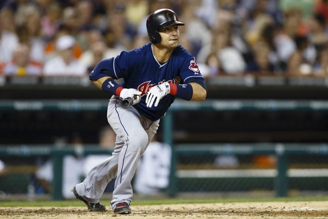 Aug 30, 2013; Detroit, MI, USA; Cleveland Indians first baseman Nick Swisher (33) hits a double sixth inning against the Detroit Tigers at Comerica Park. Mandatory Credit: Rick Osentoski-USA TODAY Sports