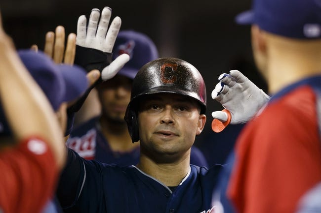 Aug 30, 2013; Detroit, MI, USA; Cleveland Indians first baseman Nick Swisher (33) congratulated by teammates after scoring sixth inning on a bases loaded walk at Comerica Park. Mandatory Credit: Rick Osentoski-USA TODAY Sports