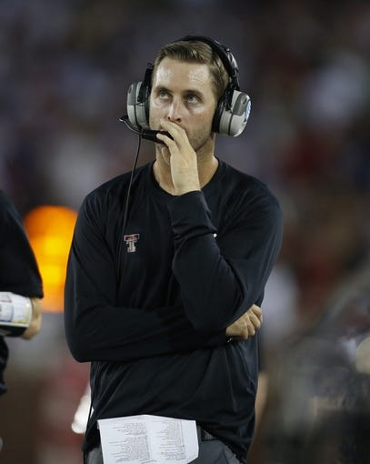 Aug 30, 2013; Dallas, TX, USA; Texas Tech Red Raiders head coach Kliff Kingsbury looks at a replay during the second quarter of the game against the Southern Methodist Mustangs at Gerald J. Ford Stadium. Mandatory Credit: Tim Heitman-USA TODAY Sports