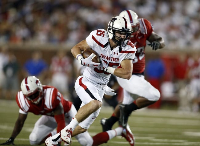 Aug 30, 2013; Dallas, TX, USA; Texas Tech Red Raiders wide receiver Jordan Davis (85) runs for a touchdown after catching a pass against the Southern Methodist Mustangs at Gerald J. Ford Stadium. Mandatory Credit: Tim Heitman-USA TODAY Sports