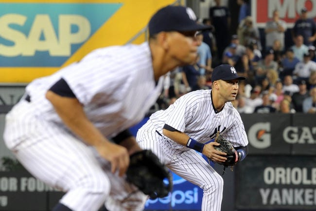 Aug 30, 2013; Bronx, NY, USA; New York Yankees third baseman Alex Rodriguez (13) and shortstop Derek Jeter (2) play the infield against the Baltimore Orioles during the eighth inning of a game at Yankee Stadium. Mandatory Credit: Brad Penner-USA TODAY Sports