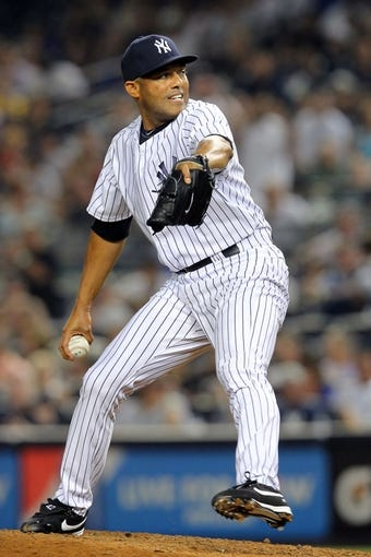 Aug 30, 2013; Bronx, NY, USA; New York Yankees relief pitcher Mariano Rivera (42) pitches against the Baltimore Orioles during the ninth inning of a game at Yankee Stadium. Mandatory Credit: Brad Penner-USA TODAY Sports