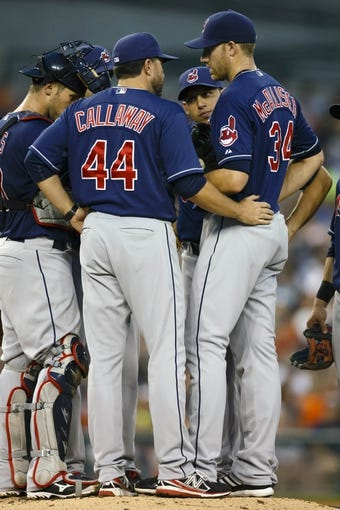 Aug 30, 2013; Detroit, MI, USA; Cleveland Indians pitching coach Mickey Callaway (44) talks to starting pitcher Zach McAllister (34) during the fourth inning against the Detroit Tigers at Comerica Park. Mandatory Credit: Rick Osentoski-USA TODAY Sports