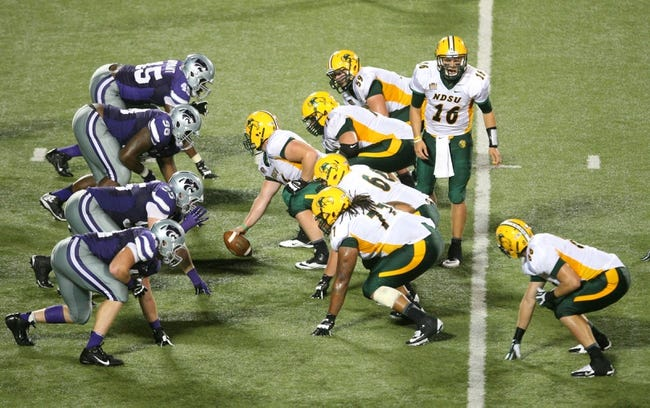 Aug 30, 2013; Manhattan, KS, USA; North Dakota State Bison quarterback Brock Jensen (16) calls a play during a 24-21 win against the Kansas State Wildcats at Bill Snyder Family Stadium. Mandatory Credit: Scott Sewell-USA TODAY Sports