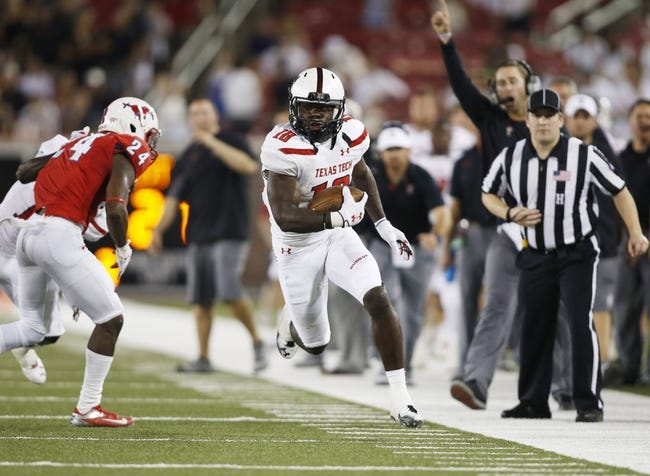 Aug 30, 2013; Dallas, TX, USA; Texas Tech Red Raiders wide receiver Eric Ward (18) runs after catching a pass in the fourth quarter of the game against the Southern Methodist Mustangs at Gerald J. Ford Stadium. Texas Tech won 41-23. Mandatory Credit: Tim Heitman-USA TODAY Sports