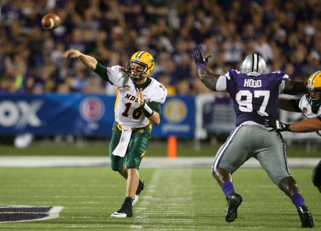 Aug 30, 2013; Manhattan, KS, USA; North Dakota State Bison quarterback Brock Jensen (16) makes a pass against Kansas State Wildcats defensive lineman Demonte Hood (97) during the Bisons' 24-21 win at Bill Snyder Family Stadium. Mandatory Credit: Scott Sewell-USA TODAY Sports