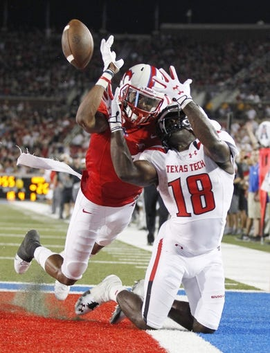 Aug 30, 2013; Dallas, TX, USA; Southern Methodist Mustangs defensive back Chris Parks (1) defends a pass against Texas Tech Red Raiders wide receiver Eric Ward (18) during the fourth quarter of the game at Gerald J. Ford Stadium. Texas Tech won 41-23. Mandatory Credit: Tim Heitman-USA TODAY Sports