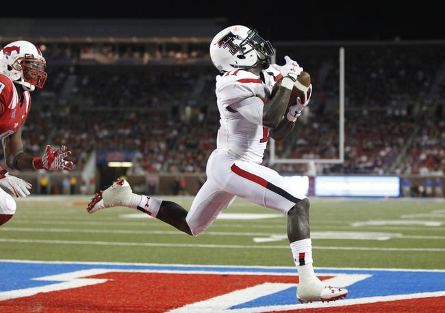 Aug 30, 2013; Dallas, TX, USA; Texas Tech Red Raiders wide receiver Jakeem Grant (11) catches a touchdown pass in the fourth quarter of the game against the Southern Methodist Mustangs at Gerald J. Ford Stadium. Texas Tech won 41-23. Mandatory Credit: Tim Heitman-USA TODAY Sports