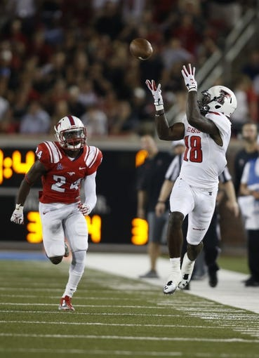 Aug 30, 2013; Dallas, TX, USA; Texas Tech Red Raiders wide receiver Dominique Wheeler (28) catches a pass while defended by Southern Methodist Mustangs defensive back JR Richardson (24) during the fourth quarter of the game at Gerald J. Ford Stadium. Texas Tech won 41-23. Mandatory Credit: Tim Heitman-USA TODAY Sports