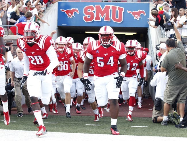 Aug 30, 2013; Dallas, TX, USA; Southern Methodist Mustangs team takes the field before the game against the Texas Tech Red Raiders at Gerald J. Ford Stadium. Texas Tech won 41-23. Mandatory Credit: Tim Heitman-USA TODAY Sports