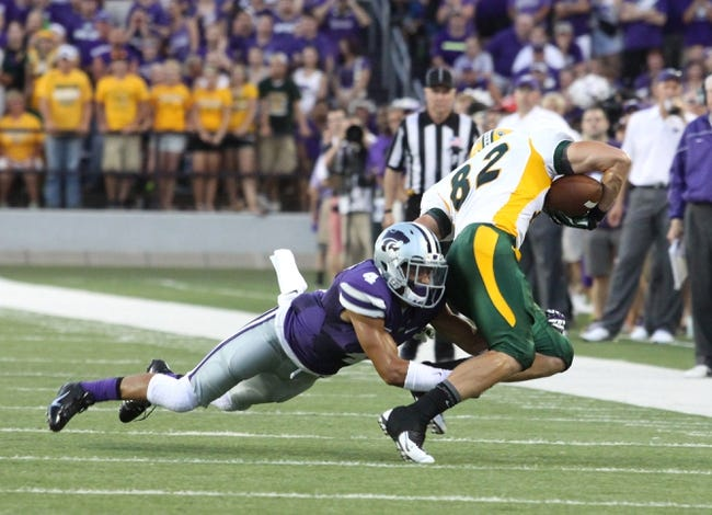 Aug 30, 2013; Manhattan, KS, USA; North Dakota State Bison wide receiver Zach Vraa (82) is tackled by Kansas State Wildcats defensive back Dorrian Roberts (4) during the Bisons' 24-21 loss at Bill Snyder Family Stadium. Mandatory Credit: Scott Sewell-USA TODAY Sports