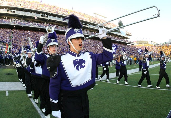 Aug 30, 2013; Manhattan, KS, USA; A trombone player with the Kansas State Wildcats Pride of Wildcat Land Marching Band takes the field for pre-game ceremonies at Bill Snyder Family Stadium. The Wildcats lost to the North Dakota State Bison, 24-21.Mandatory Credit: Scott Sewell-USA TODAY Sports