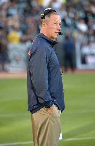 Aug 23, 2013; Oakland, CA, USA; Chicago Bears offensive coordinator Aaron Kromer against the Oakland Raiders at O.co Coliseum. Mandatory Credit: Kirby Lee-USA TODAY Sports