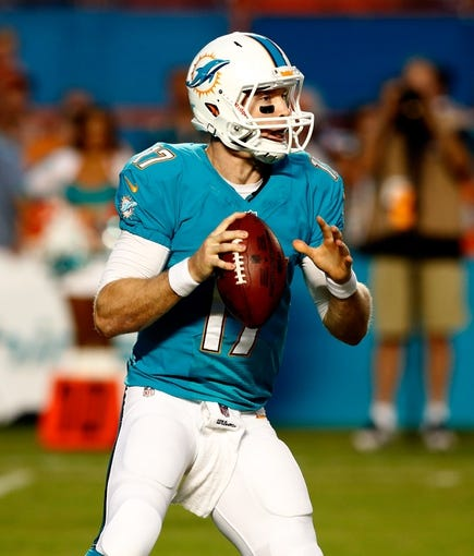 Aug 24, 2013; Miami Gardens, FL, USA; Miami Dolphins quarterback Ryan Tannehill (17) in the first quarter of a game against the Tampa Bay Buccaneers at Sun Life Stadium.  Mandatory Credit: Robert Mayer-USA TODAY Sports