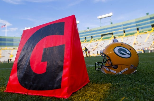Aug 23, 2013; Green Bay, WI, USA; A Green Bay Packers helmet sits on the field during warmups prior to the game against the Seattle Seahawks at Lambeau Field.  Seattle won 17-10.  Mandatory Credit: Jeff Hanisch-USA TODAY Sports