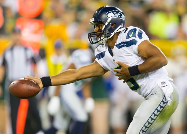 Aug 23, 2013; Green Bay, WI, USA; Seattle Seahawks quarterback Russell Wilson (3) during the game against the Green Bay Packers at Lambeau Field.  Seattle won 17-10.  Mandatory Credit: Jeff Hanisch-USA TODAY Sports