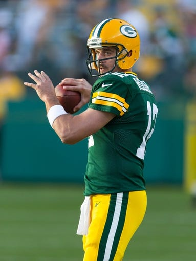 Aug 23, 2013; Green Bay, WI, USA; Green Bay Packers quarterback Aaron Rodgers (12) during warmups prior to the game against the Seattle Seahawks at Lambeau Field.  Seattle won 17-10.  Mandatory Credit: Jeff Hanisch-USA TODAY Sports