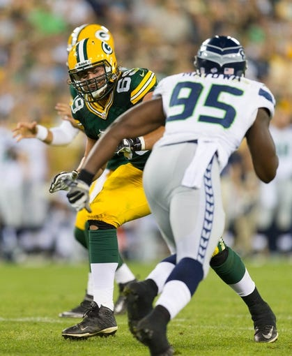 Aug 23, 2013; Green Bay, WI, USA; Green Bay Packers offensive tackle David Bakhtiari (69) during the game against the Seattle Seahawks at Lambeau Field.  Seattle won 17-10.  Mandatory Credit: Jeff Hanisch-USA TODAY Sports