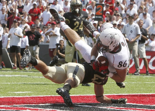 Aug 31, 2013; Cincinnati, OH, USA; Cincinnati Bearcats tight end Blake Annen (86) falls into the end zone for a touchdown against Purdue Boilermakers safety Landon Feichter (44) during the second quarter at Nippert Stadium. Mandatory Credit: David Kohl-USA TODAY Sports