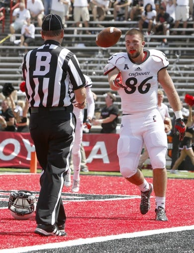 Aug 31, 2013; Cincinnati, OH, USA; Cincinnati Bearcats tight end Blake Annen (86) throws the ball to an official after scoring a second quarter touchdown against the Purdue Boilermakers at Nippert Stadium. Mandatory Credit: David Kohl-USA TODAY Sports