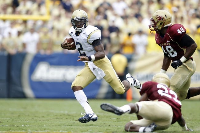 Aug 31, 2013; Atlanta, GA, USA; Georgia Tech Yellow Jackets quarterback Vad Lee (2) runs the ball against the Elon Phoenix in the first quarter at Bobby Dodd Stadium. Mandatory Credit: Brett Davis-USA TODAY Sports