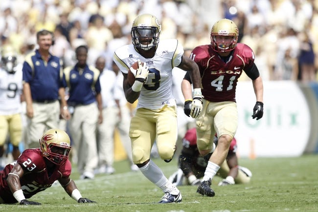 Aug 31, 2013; Atlanta, GA, USA; Georgia Tech Yellow Jackets running back Dennis Andrews (3) runs the ball against the Elon Phoenix in the first quarter at Bobby Dodd Stadium. Mandatory Credit: Brett Davis-USA TODAY Sports