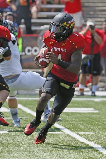 Aug 31, 2013; College Park, MD, USA; Maryland Terrapins kick returner Stefon Diggs (1) returns a punt against the Florida International Panthers at Byrd Stadium. Mandatory Credit: Mitch Stringer-USA TODAY Sports