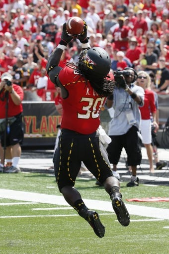 Aug 31, 2013; College Park, MD, USA; Maryland Terrapins running back Kenneth Goins (30) catches a touchdown pass from quarterback C.J. Brown (not shown) against the Florida International Panthers at Byrd Stadium. Mandatory Credit: Mitch Stringer-USA TODAY Sports