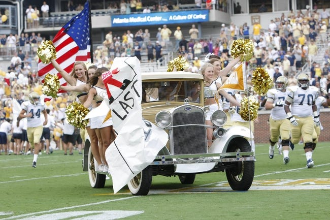 Aug 31, 2013; Atlanta, GA, USA; Georgia Tech Yellow Jackets mascot Ramblin Wreck car drives on the field with cheerleaders before a game against the Elon Phoenix at Bobby Dodd Stadium. Mandatory Credit: Brett Davis-USA TODAY Sports
