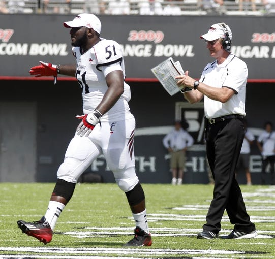 Aug 31, 2013; Cincinnati, OH, USA; Cincinnati Bearcats head coach Tommy Tubberville (right) and linebacker Greg Blair (51) react after a third quarter touchdown during a game against the Purdue Boilermakers at Nippert Stadium. Cincinnati won 42-7. Mandatory Credit: David Kohl-USA TODAY Sports