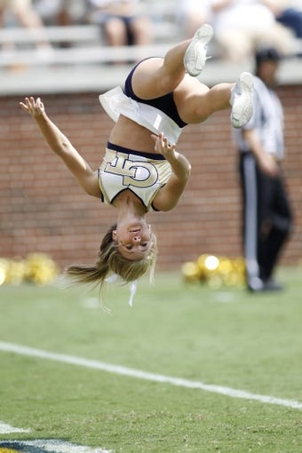 Aug 31, 2013; Atlanta, GA, USA; Georgia Tech Yellow Jackets cheerleader tumbles after a touchdown against the Elon Phoenix in the third quarter at Bobby Dodd Stadium. Georgia Tech defeated Elon 70-0. Mandatory Credit: Brett Davis-USA TODAY Sports