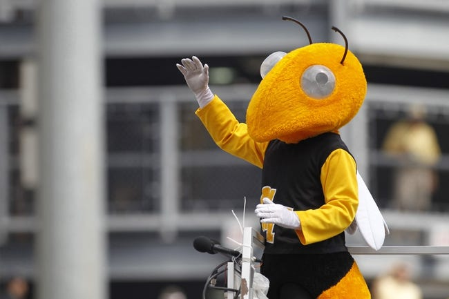 Aug 31, 2013; Atlanta, GA, USA; Georgia Tech Yellow Jackets mascot Buzz leads the band against the Elon Phoenix in the third quarter at Bobby Dodd Stadium. Georgia Tech defeated Elon 70-0. Mandatory Credit: Brett Davis-USA TODAY Sports