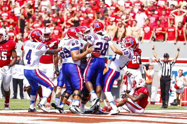 August 31, 2013; Raleigh, NC, USA;   Louisiana Tech running back Kenneth Dixon (28) celebrates his 4th quarter touchdown with teammates against North Carolina State at Carter Finley Stadium. North Carolina State defeated Louisiana Tech 40-14. Mandatory Credit: James Guillory-USA TODAY Sports
