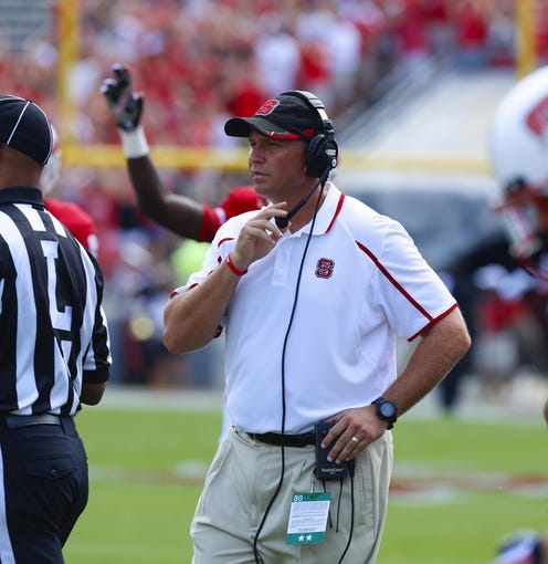 August 31, 2013; Raleigh, NC, USA;  North Carolina State head coach Dave Doeren on the sidelines during the game against Louisiana Tech at Carter Finley Stadium. North Carolina State defeated Louisiana Tech 40-14. Mandatory Credit: James Guillory-USA TODAY Sports
