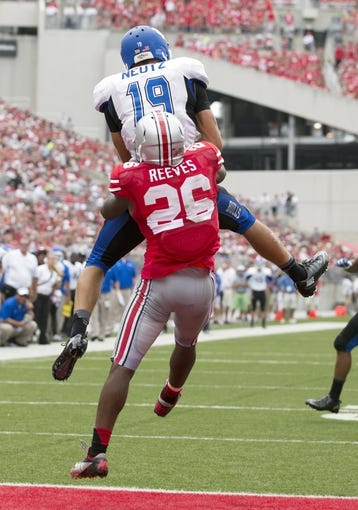 Aug 31, 2013; Columbus, OH, USA; Buffalo Bulls wide receiver Alex Neutz (19)catches a touchdown pass as Ohio State Buckeyes cornerback Armani Reeves (26) defends at Ohio Stadium. Ohio State won the game 40-20. Mandatory Credit: Greg Bartram-USA TODAY Sports