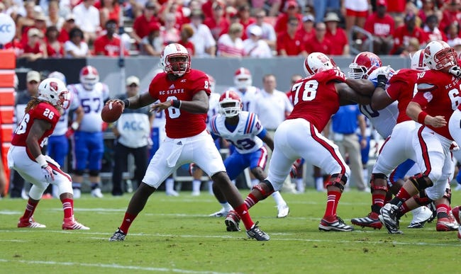 August 31, 2013; Raleigh, NC, USA;  North Carolina State quarterback Brandon Mitchell (8) gets ready to make a throw during the 1st quarter against Louisiana Tech at Carter Finley Stadium. North Carolina State defeated Louisiana Tech 40-14. Mandatory Credit: James Guillory-USA TODAY Sports