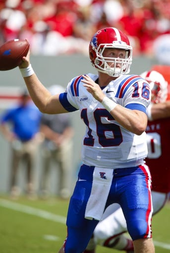 August 31, 2013; Raleigh, NC, USA;   Louisiana Tech quarterback Scotty Young (16) gets ready to make a throw against North Carolina State at Carter Finley Stadium. North Carolina State defeated Louisiana Tech 40-14. Mandatory Credit: James Guillory-USA TODAY Sports