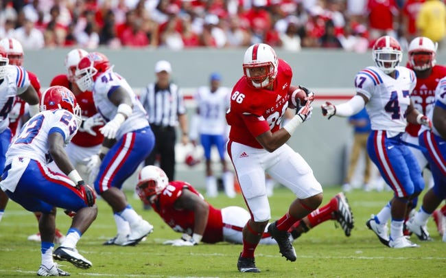 August 31, 2013; Raleigh, NC, USA;  North Carolina State tight end David J. Grinnage (86) carries the ball after making a catch against Louisiana Tech at Carter Finley Stadium. North Carolina State defeated Louisiana Tech 40-14. Mandatory Credit: James Guillory-USA TODAY Sports