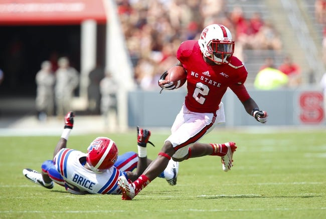 August 31, 2013; Raleigh, NC, USA;  North Carolina State wide receiver Rashard Smith (2) looks up field after making a catch against Louisiana Tech at Carter Finley Stadium. North Carolina State defeated Louisiana Tech 40-14. Mandatory Credit: James Guillory-USA TODAY Sports