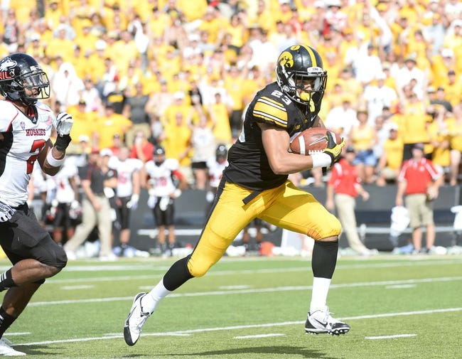 Aug 31, 2013; Iowa City, IA, USA; Iowa Hawkeyes wide receiver Jordan Cotton (23) makes a catch against the Northern Illinois Huskies during the second quarter at Kinnick Stadium. Mandatory Credit: Mike DiNovo-USA TODAY Sports