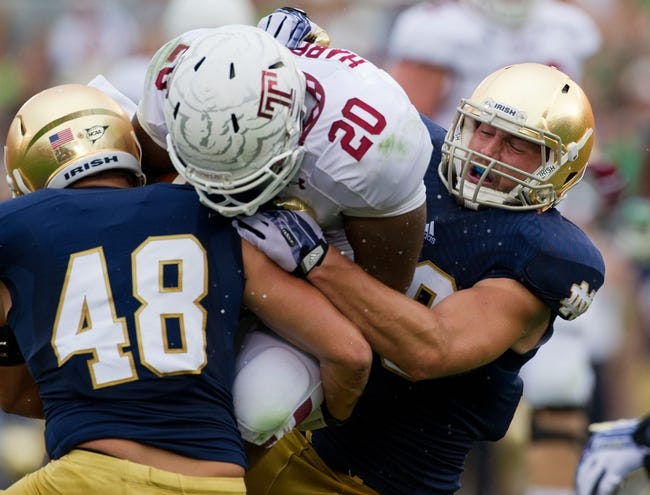 Aug 31, 2013; South Bend, IN, USA; Notre Dame Fighting Irish linebacker Dan Fox (48) and linebacker Jarrett Grace (59) tackle Temple Owls halfback Kenny Harper (20) in the first quarter at Notre Dame Stadium. Notre Dame won 28-6. Mandatory Credit: Matt Cashore-USA TODAY Sports