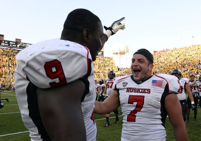 Aug 31, 2013; Iowa City, IA, USA; Northern Illinois Huskies linebacker Rasheen Lemon (9) reacts with linebacker Michael Santacaterina (7) after the game against the Iowa Hawkeyes at Kinnick Stadium. Northern Illinois defeats Iowa 30-27.Mandatory Credit: Mike DiNovo-USA TODAY Sports
