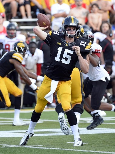 Aug 31, 2013; Iowa City, IA, USA; Iowa Hawkeyes quarterback Jake Rudock (15) drops back to pass against the Northern Illinois Huskies during the fourth quarter at Kinnick Stadium. Northern Illinois defeats Iowa 30-27. Mandatory Credit: Mike DiNovo-USA TODAY Sports