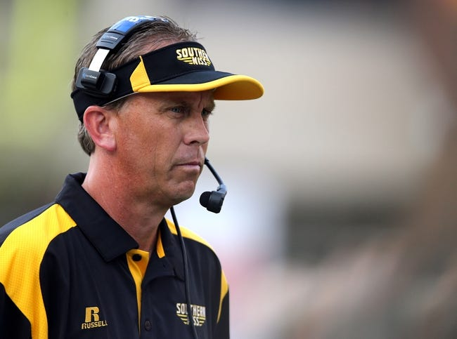 Aug 31, 2013; Hattiesburg, MS, USA; Southern Miss Golden Eagles head coach Todd Monken on the field in the first quarter during their game against the Texas State Bobcats at M.M. Roberts Stadium. Mandatory Credit: Chuck Cook-USA TODAY Sports